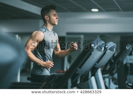 Geschikt man jogging tredmolen gymnasium glimlach Stockfoto © wavebreak_media