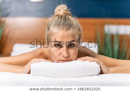 beautiful blonde lying on massage table stock photo © wavebreak_media