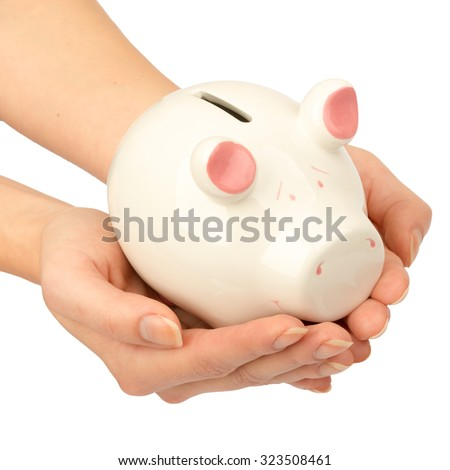 Pigggy bank in womans hands Stock photo © cherezoff