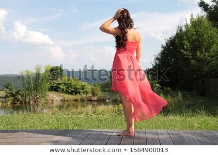 Mulher em pé terraço belo sorrindo arenoso Foto stock © dmitroza
