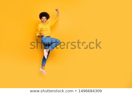 Happy african woman in sweater and jeans Stock photo © deandrobot