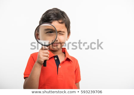Young student with magnifying glass isolated on white Stock photo © Elnur