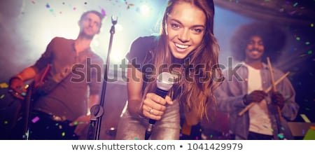 Young singer with musicians performing at nightclub Stock photo © wavebreak_media