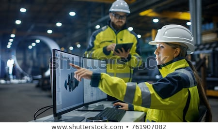 woman working on blueprints Stock photo © IS2