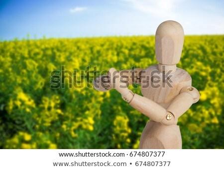 Wooden figurine performing yoga on floor Stock photo © wavebreak_media
