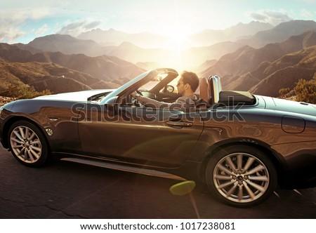 happy young woman posing at convertible car Stock photo © dolgachov