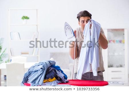Férj égő ruházat vasalás telefon munka Stock fotó © Elnur