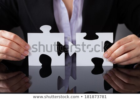Businessperson's Hand Holding Two Jigsaw Puzzle Stock photo © AndreyPopov