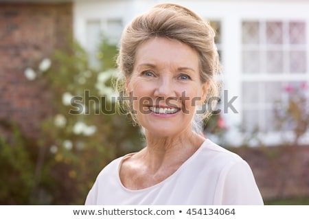 Portrait of a happy senior woman at home Stock photo © Lopolo