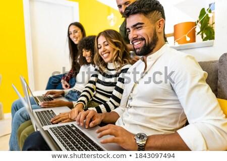 Vista lateral feliz jovem mulheres sessão Foto stock © wavebreak_media