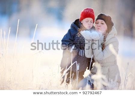 Mother and son enjoying beautiful winter day outdoors Stock photo © galitskaya