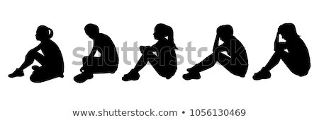 Stock photo: woman sitting on the floor