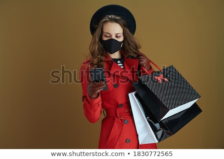 stylish woman with golden mask and gift stock photo © anna_om