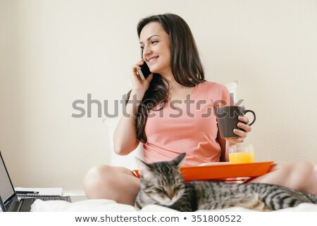 kobieta · bed · mówić · telefonu · pomarańczowy · taca - zdjęcia stock © pekour