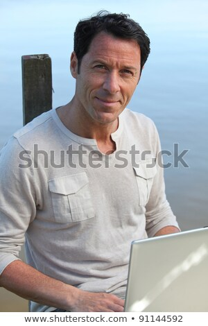 Man sitting on a jetty e Stock photo © photography33