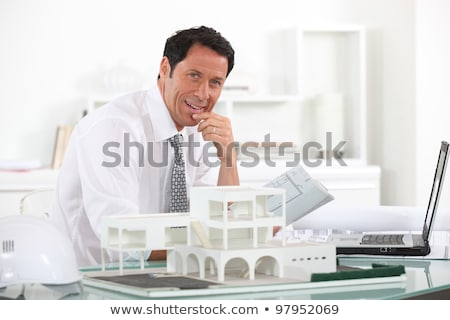 Architect sat at desk with model house Stock photo © photography33