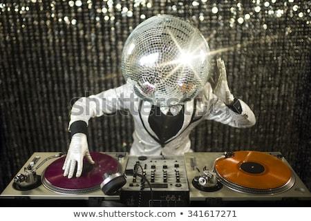 party dancer with disco ball Stock photo © dolgachov
