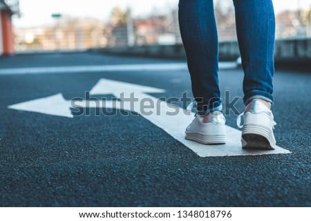 woman with direction arrow sign stock photo © dolgachov