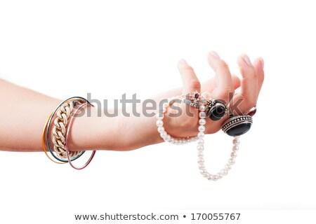 женщину · рук · полный · жемчуга - Сток-фото © konradbak