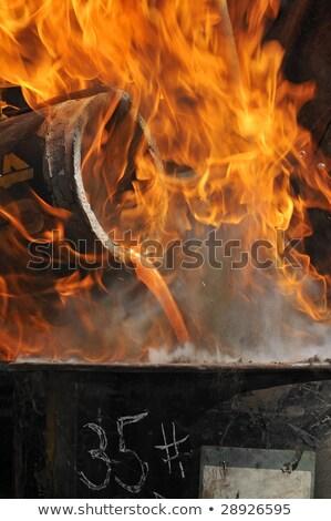 Pouring Molten Metal into Mold - focus on pour Stock photo © rufous