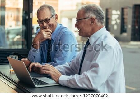 boldog · idős · üzletember · számítógéphasználat · portré · laptopot · használ - stock fotó © nyul