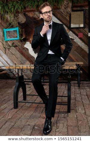 Man smoking vergadering gelukkig elegante Stockfoto © feedough
