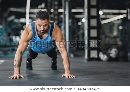 Muscular man doing exercise on biceps Stock photo © julenochek