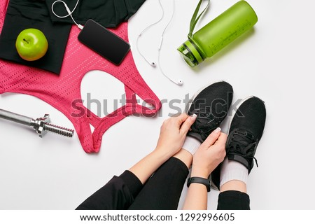 Athletic young woman works out with green dumbbells Stock photo © julenochek