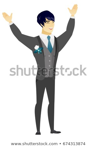 Successful asian bridegroom jumping. Stock photo © RAStudio