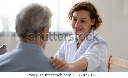 Enfermera mirando feliz masculina paciente clínica Foto stock © AndreyPopov