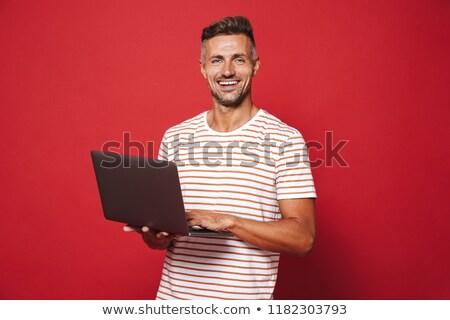 Kép elragadtatott férfi csíkos póló mosolyog Stock fotó © deandrobot