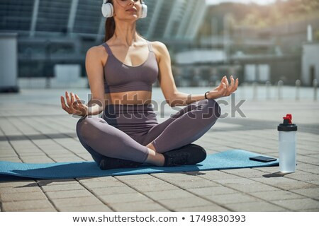 Cropped image of calm young sportswoman Stock photo © deandrobot