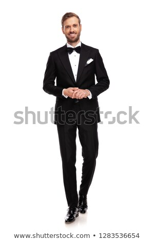 attractive businessman holds palms together and steps forward Stock photo © feedough