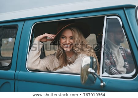 passenger woman in in car with hat Stock photo © Lopolo