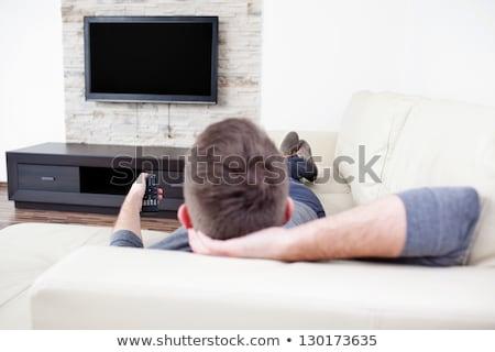男 リモコン を見て テレビ 顔 幸せ ストックフォト © Lopolo