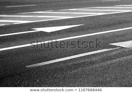 close up of arrow road surface marking on asphalt Stock photo © dolgachov