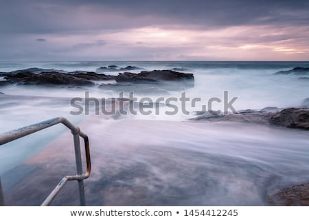 Large waves engulf the public rock pool in Bermagui Stock photo © lovleah