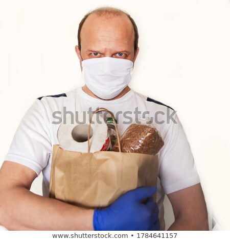 woman delivering donuts to man stock photo © andreypopov