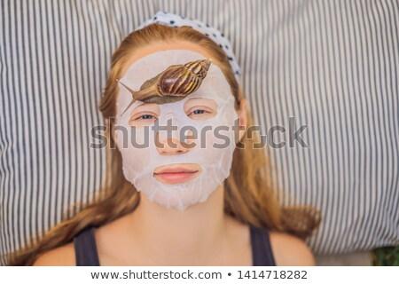 若い女性 顔 マスク カタツムリ 健康 ストックフォト © galitskaya
