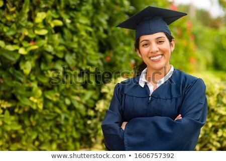 happy female graduate student in mortarboard Stock photo © dolgachov