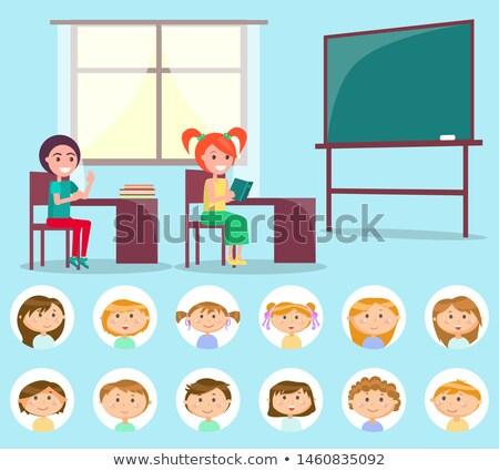 Side view of kids studying in classroom sitting at desks in school Stock photo © wavebreak_media