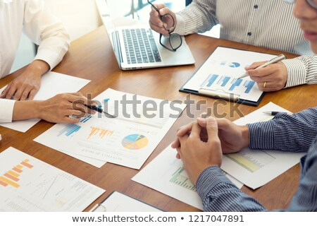 Woman Presents Financial Report, Investment Board Stock photo © robuart