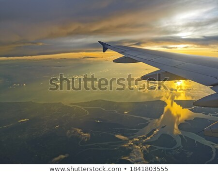 jet plane over the sea at sunset time stock photo © moses