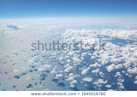 White clouds and blue sky high above the Atlantic ocean. Stock photo © latent