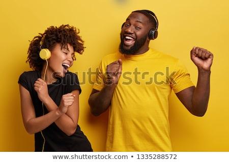 Iki arkadaşlar genç kadın kulaklık ev Stok fotoğraf © studiofi