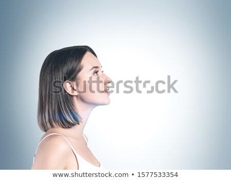 girl near a wall looking up stock photo © carlodapino
