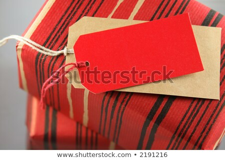 Little Red Wrapped Present With Tag Foto stock © hfng