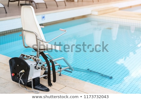 Access to a swimming pool Stock photo © elxeneize