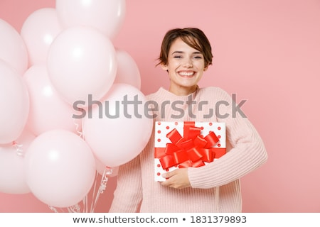 happy woman holding with a cardboard stock photo © iko