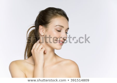 Young female touches her neck, white background Stock photo © Nobilior